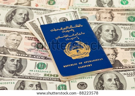 Afghan passport on US dollars background - stock photo
