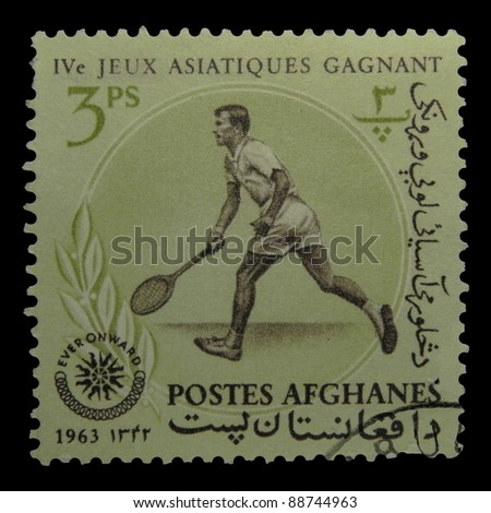 "AFGHANISTAN - CIRCA 1963: A stamp printed in Afghanistan shows Tennis with the inscription ""IV Asian Games"" from the series ""IV Asian Games"", circa 1963"