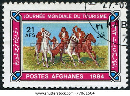 AFGHANISTAN - CIRCA 1984: A stamp printed in the Afghanistan devoted to World Tourism Day. Depicted Horsemen playing buzkashi, circa 1984
