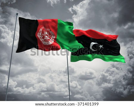Afghanistan & Libya Flags are waving in the sky with dark clouds - stock photo