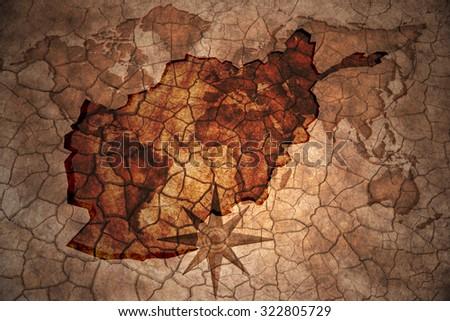afghanistan map on vintage crack paper background - stock photo