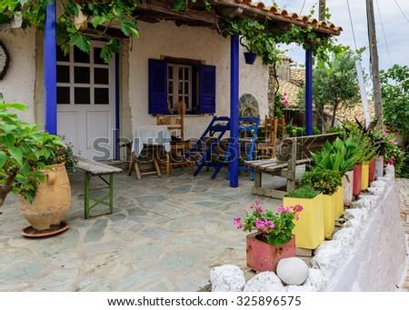 Afionas garden village little street, Corfu, Greece. - stock photo