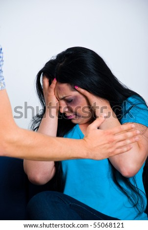 Afraid abused woman being scared by her husband - stock photo