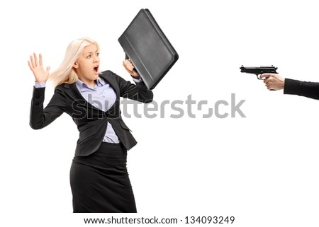 Afraid businesswoman from a gun isolated on white background - stock photo