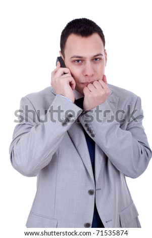 afraid looking business man with a phone isolated on white - stock photo