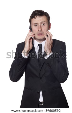 afraid looking businessman with a phone in a black suite isolated on white - stock photo