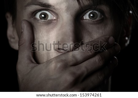 Afraid man covering his mouth by the hand - stock photo