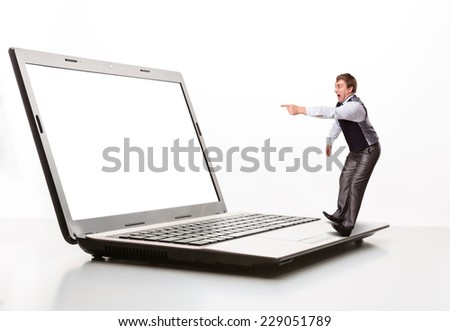 Afraid man points to the monitor - stock photo