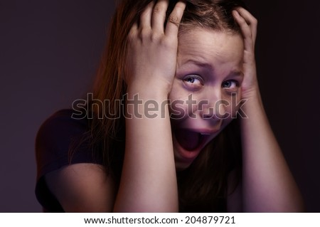 Afraided teen girl experiences fear - stock photo