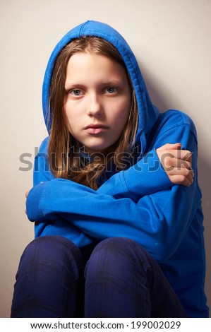 Afraided teen girl, studio shot - stock photo