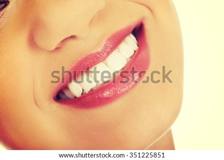 Afrian woman's mouth with perfect smile. - stock photo
