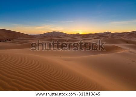 Africa - Erg Chebbi Dunes -  Sahara Desert - at sunrise, in Morocco - stock photo