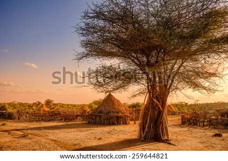 Africa, Ethiopia, huts in a Hamer village in the sunset light - stock photo