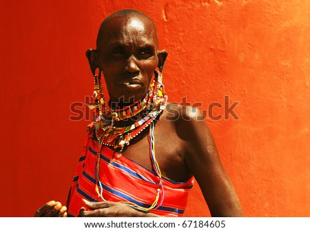 AFRICA,KENYA,Amboseli -NOVEMBER 5:Portrait of an Amboseli tribe woman wearing traditional handmade accessories,review of daily life of local people,near to Amboseli National Park,November 5,2008,Kenya - stock photo