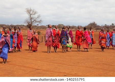AFRICA, KENYA, MASAI MARA - JULY 2: Masai females dancing traditional jumps as cultural ceremony near to Masai Mara National Park Reserve, July 2,2011,Kenya - stock photo