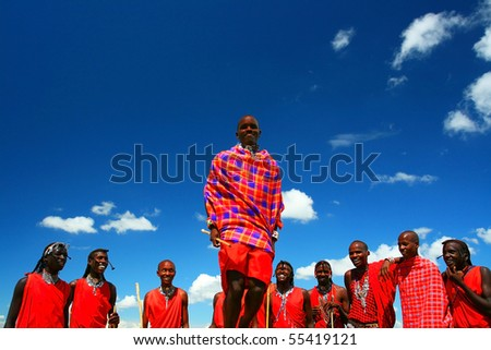AFRICA,KENYA,MASAI MARA,NOVEMBER12:Masai warriors dancing traditional jumps as cultural ceremony,review of daily life of local people, near to Masai Mara National Park Reserve, November 12, 2008 Kenya - stock photo