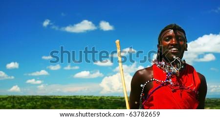 AFRICA,KENYA,MASAI MARA-NOVEMBER 12:Masai warriors dancing traditional jumps as cultural ceremony,review of daily life of local people,near Masai Mara National Park Reserve,November 12,2008 in Kenya - stock photo