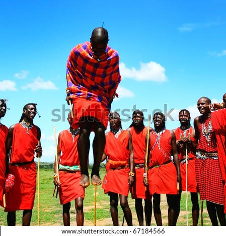 AFRICA,KENYA,MASAI MARA - NOVEMBER 12:Masai warriors dancing traditional jumps as cultural ceremony,review of daily life of local people,near to Masai Mara National Park Reserve,November 12,2008,Kenya - stock photo