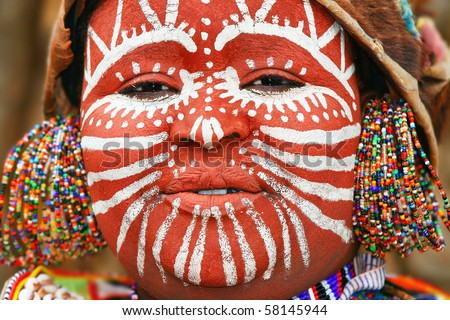 AFRICA, KENYA, NAKURU - NOVEMBER 9:Portrait of a Kenyan warrior with traditionally painted face,review of daily life of local people, near to Lake Nakuru National Park Reserve, November 9, 2008, Kenya - stock photo