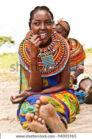 AFRICA,KENYA, SAMBURU - NOVEMBER 8: Portrait of Samburu  woman wearing traditional handmade accessories, review of daily life of local people, near Samburu Park National Reserve, November 8, 2008, Kenya - stock photo