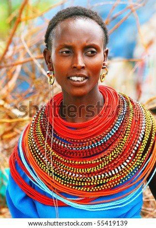 AFRICA,KENYA,SUMBURU,NOVEMBER 8: Portrait of Sumburu  woman wearing traditional handmade accessories,  review of daily life of local people, near Sumburu Park National Reserve, November 8, 2008, Kenya - stock photo