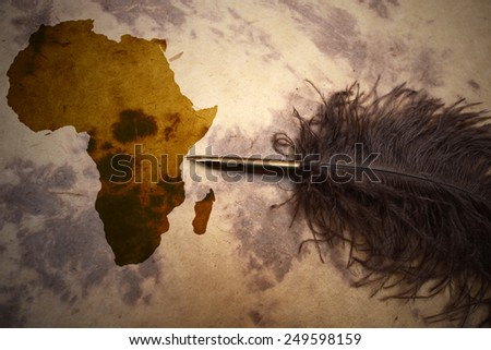 Africa map on vintage paper with old pen - stock photo