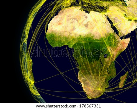 Africa viewed from space with connections representing main air traffic routes. Elements of this image furnished by NASA. - stock photo
