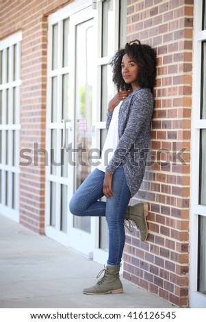 African American, adult student, girl smiling outside white teeth, university, united states, model, teenager, teenage, teen, young beautiful girl, female portrait, black, outdoor, happy young girl  - stock photo