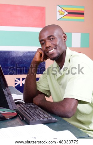 african american adult student in front of computer - stock photo