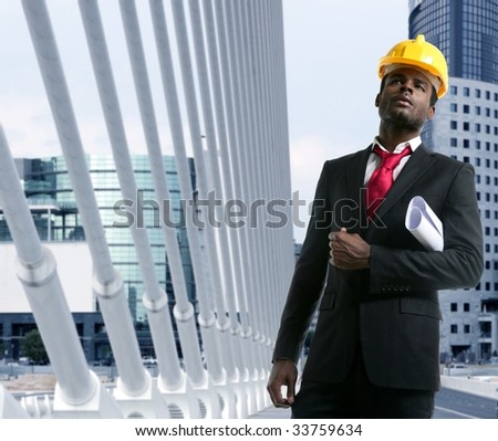 African american architect engineer with yellow hardhat and plans [Photo Illustration] - stock photo