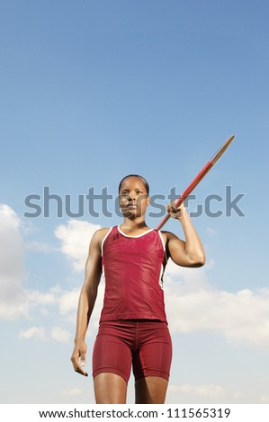 African American athlete woman ready to throw javelin - stock photo