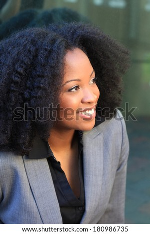 African American Attractive Professional Business Professional Wearing Suit and Black Shirt Businesswoman