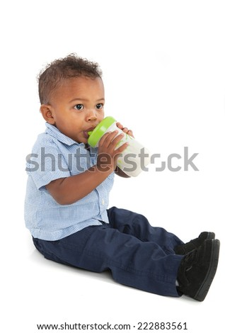 African American Baby Boy Drinking Milk Bottle on Isolated White Background - stock photo
