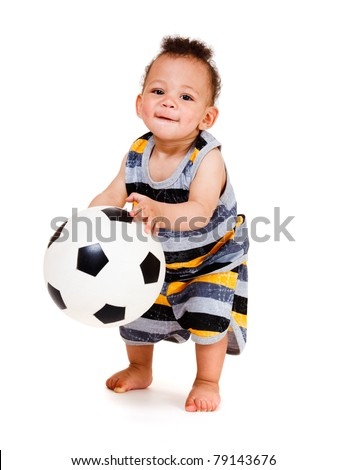 African american baby boy holding soccer ball - stock photo