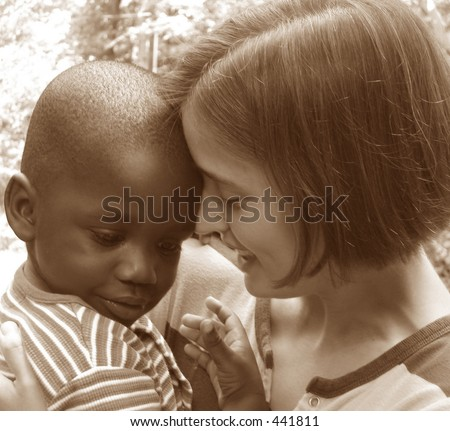 African American baby boy with young Caucasian woman.  Sepia tone image.