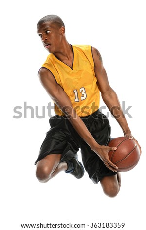 African American basketball player dunking ball isolated over white background - stock photo