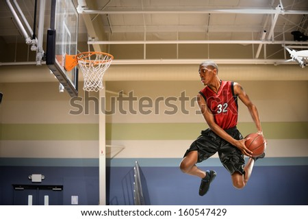 African American basketball player in action in indoor court - stock photo