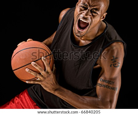 African american basketball player playing strong. - stock photo