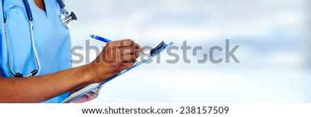 African-American black doctor woman over blue background. - stock photo