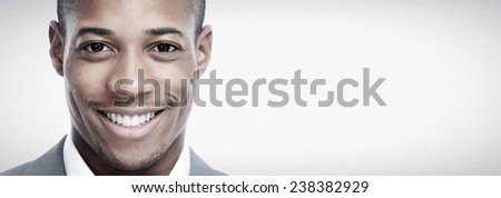 African-American black man face over grey background - stock photo