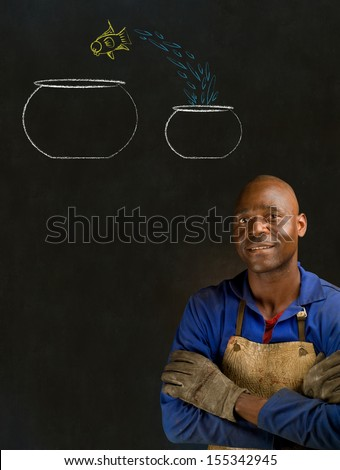 African American black man industrial worker with chalk jumping fish bowls on a blackboard background - stock photo