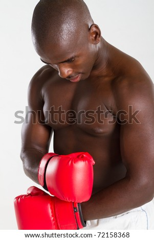 african american bodybuilder with boxing gloves - stock photo
