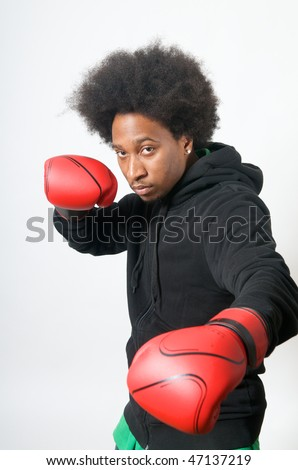 African American Boxer with red boxing gloves in attack - stock photo