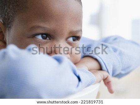 African American boy daydreaming - stock photo
