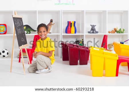 african american boy in preschool classroom - stock photo