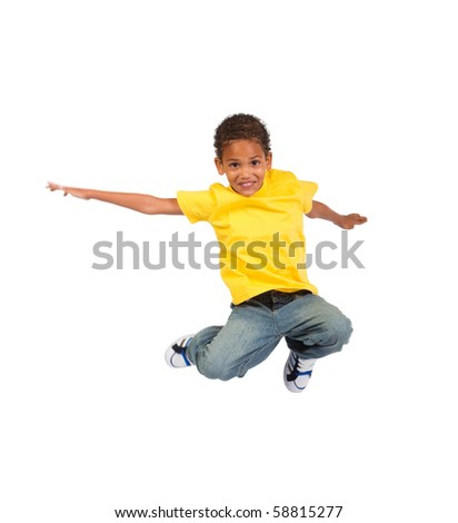 african american boy jumping over white background - stock photo