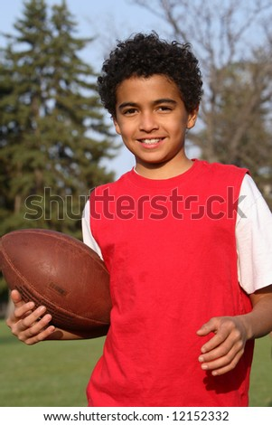 African American boy playing a football