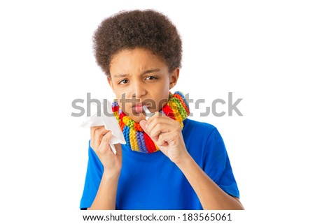 African American boy with nasal spray and tissue, colorful scarf, concept of allergy and flu. Over white background, isolated, with copy space. - stock photo