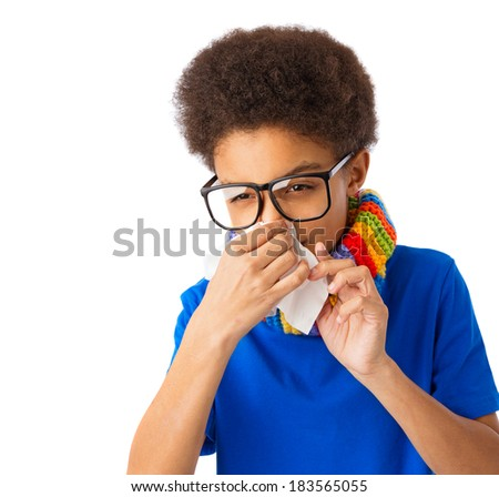 African American boy with tissue, eyeglasses and colorful scarf, concept of allergy and flu. Over white background, isolated, with copy space. - stock photo