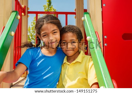 African american brother and sister at the playground - stock photo